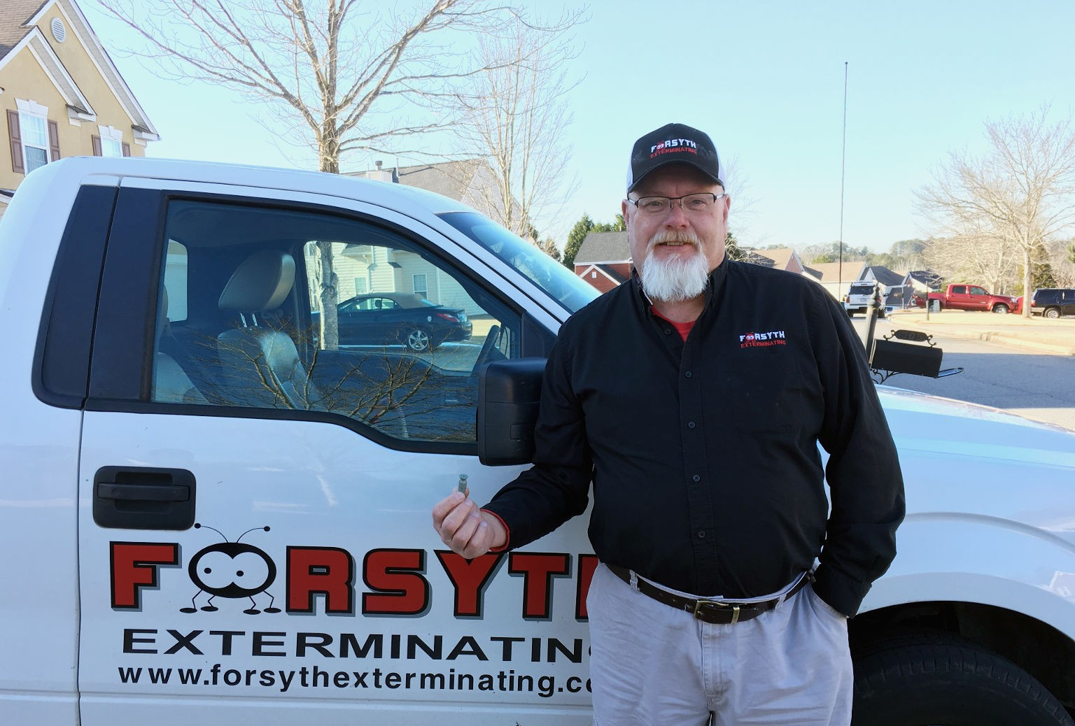 Testimonials: Forsyth Exterminating's (Pest control) technician holding a MABI injector